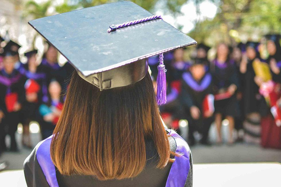 Back of a Graduates Head facing her collegues.