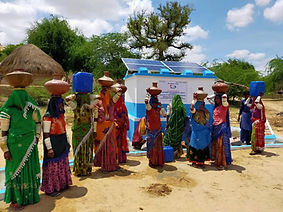 Group of ladies collecting from a water well