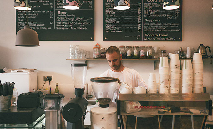 man operating cafe