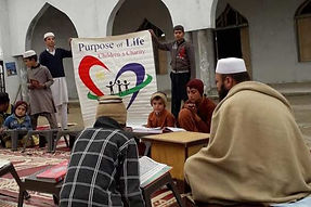 People sitting down to pray at a new mosque