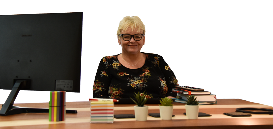 Wendy Ward from Let's Save sitting at her desk