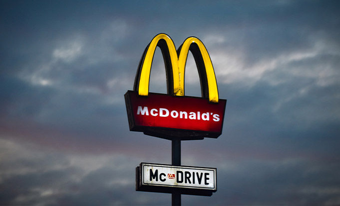 Mcdonalds Drive Thru logo with a cloudy background