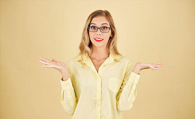 confused young woman with a yellow background