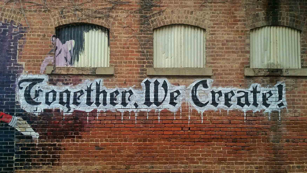 Together we Create written on wall in paint