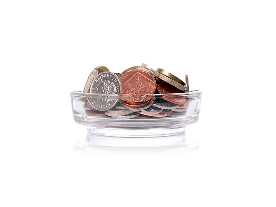 uk money in an ashtray