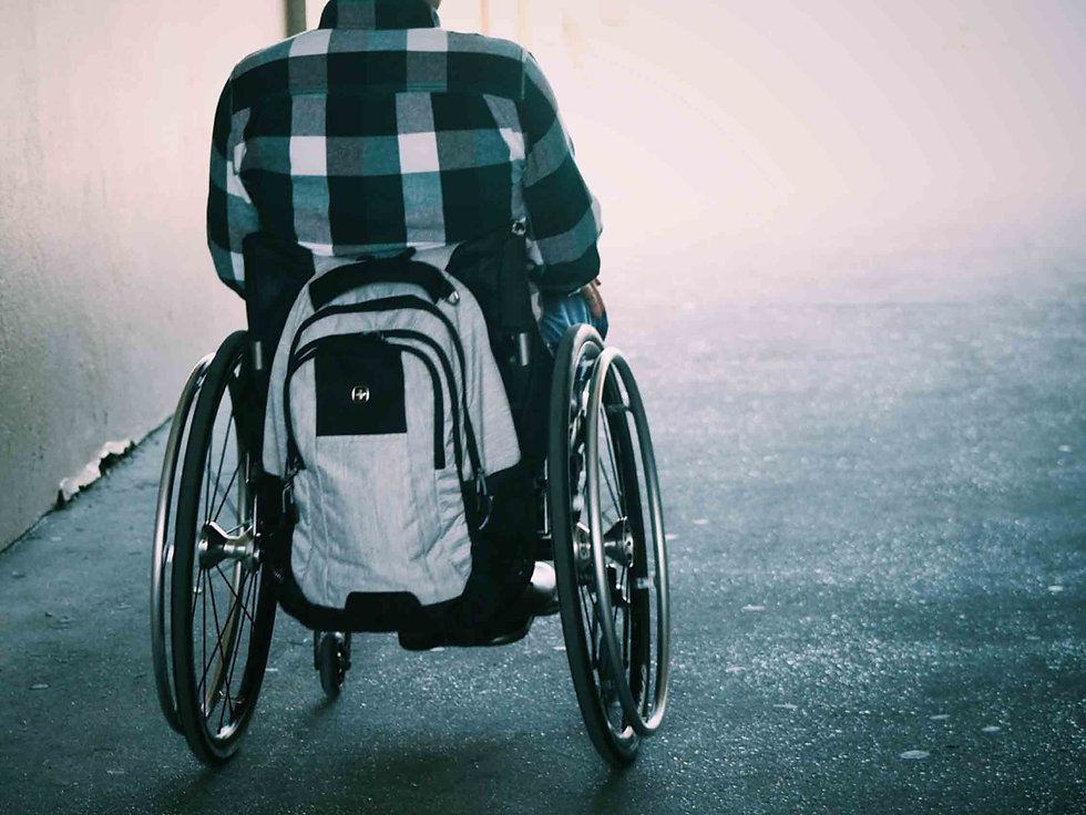 man in wheelchair with backpack