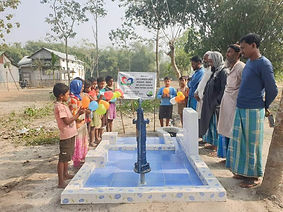 Indian people surrounding a newly constructed water well