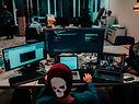 Designer with hat using adobe premiere pro software