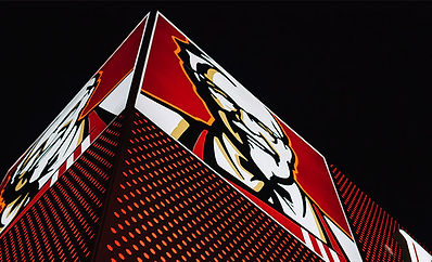 The upshot of KFC logo on the corner of a building