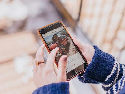 Woman scrolling through Instagram