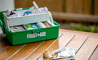 First aid Box on a wood surface