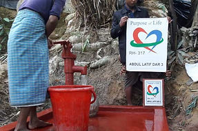 People using a new installed red water pump in Rohingya