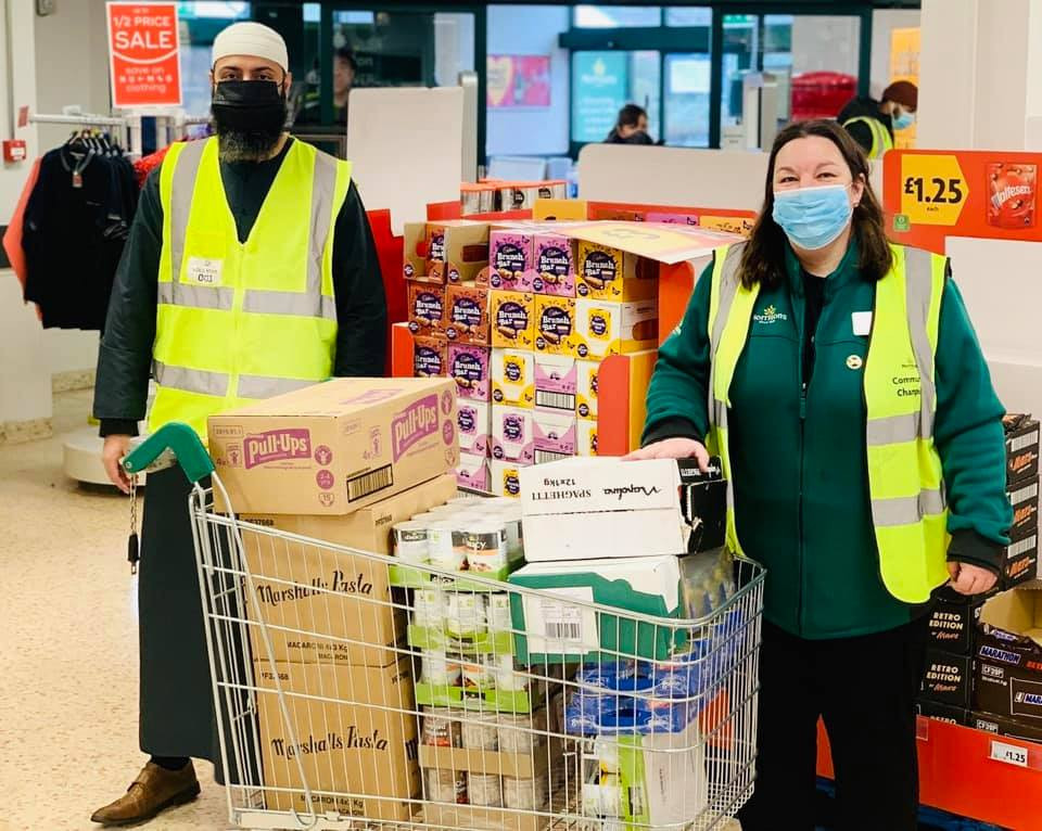 Purpose of life receiving a donation from Morrisons in Heckmondwike