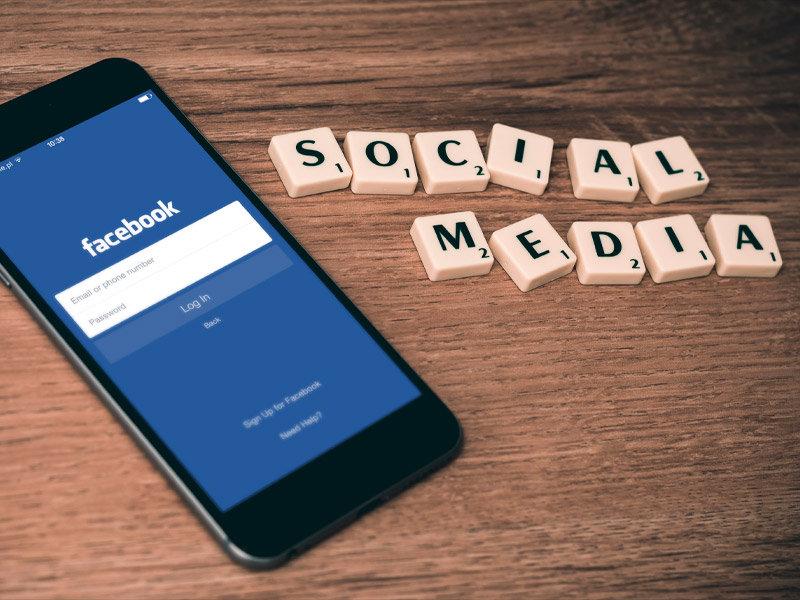Mobile phone displaying Facebook logo
