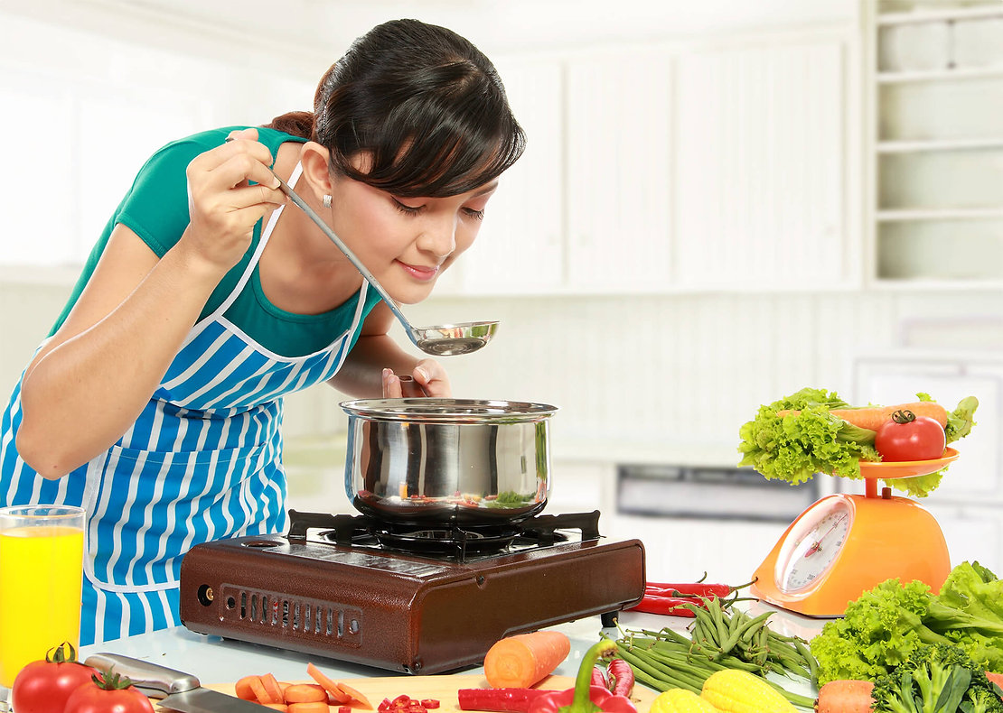 Girl-Cooking-on-Stove-Top-and-Tasting-Fo