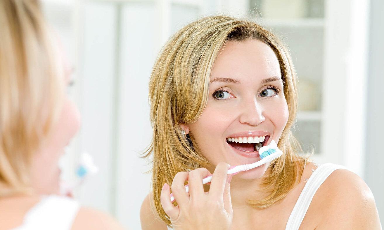 Beautiful Happy Woman Brushing Teeth_edi
