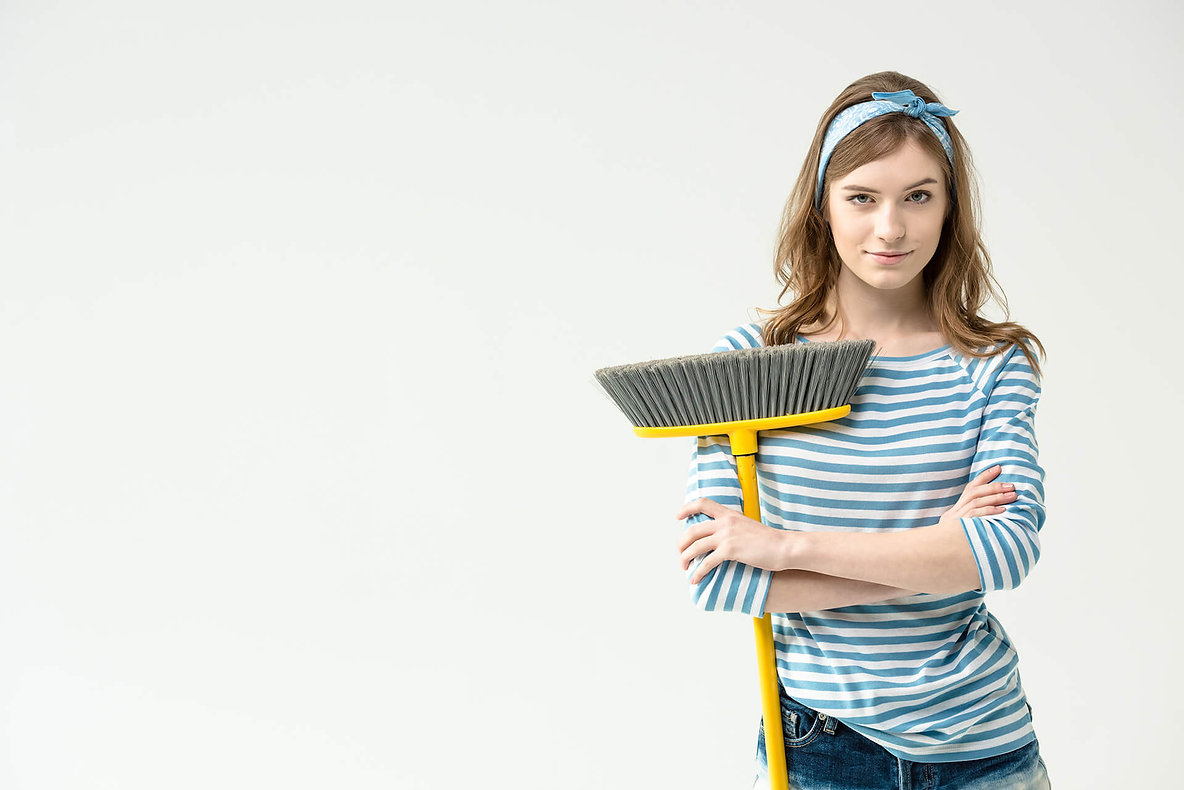 Young Girl with Broom Cleaning.jpg