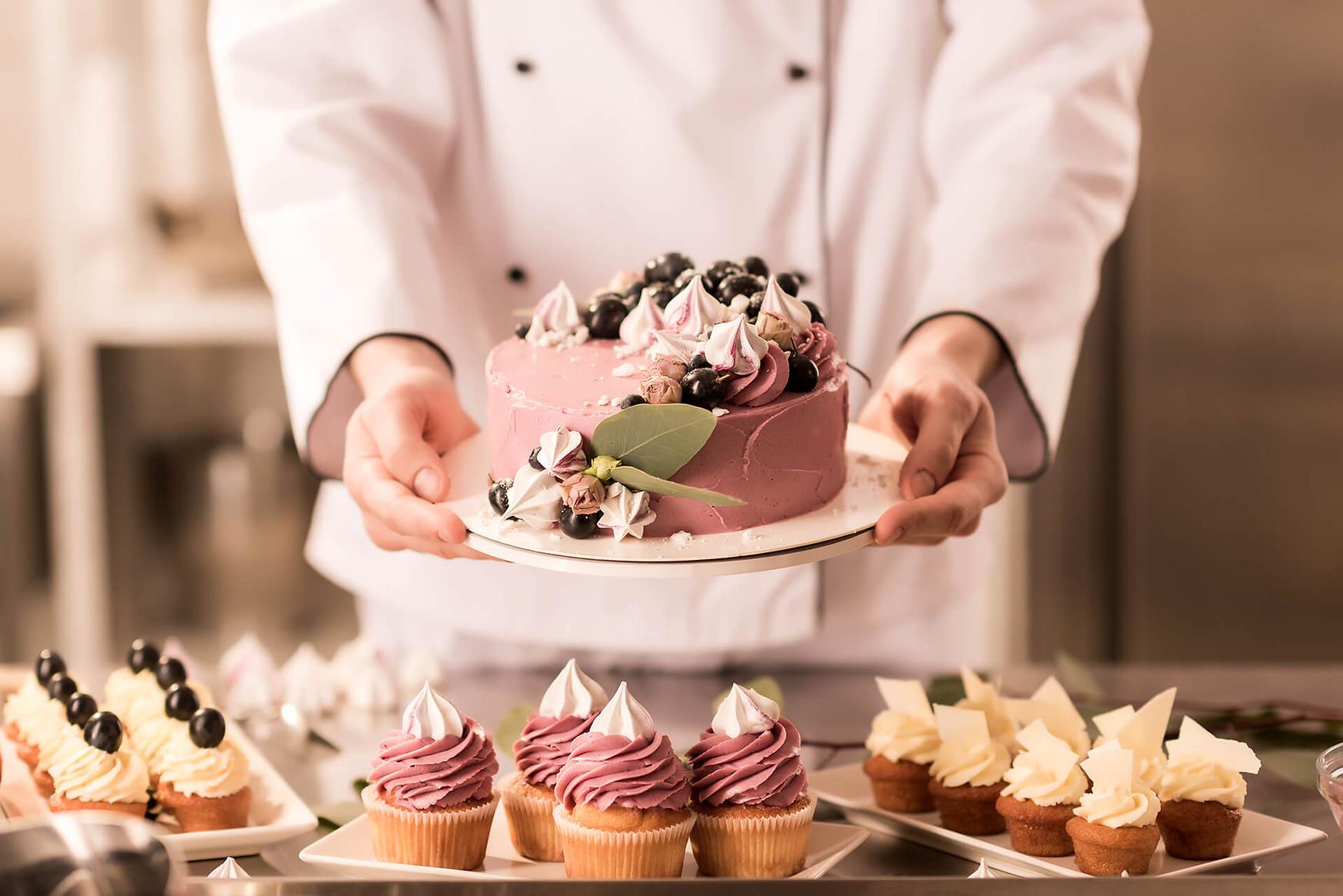 A-Chef-Presenting-a-Cake.jpg