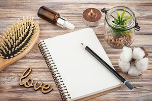 Empty notebook, hair brush, oil, blogger