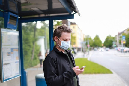corporate-mobility-in-covid19-times-man-with-mask-waiting-for-bus