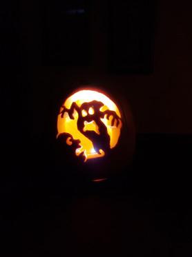 Lit up pumpkin carving.  Boo!