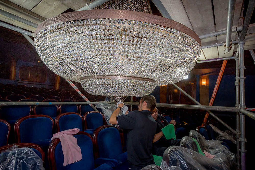 cleaning the lights at the Jersey Opera house