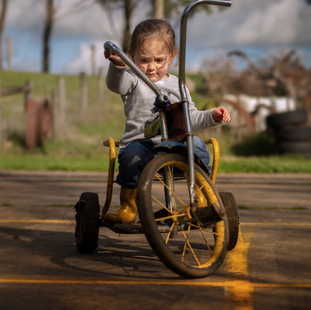 little girl on tricycle at Echo Farm Mou