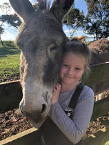 girl cudling donkey at Echo Farm Mount G