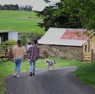Couple walking towards stone shed at Ech