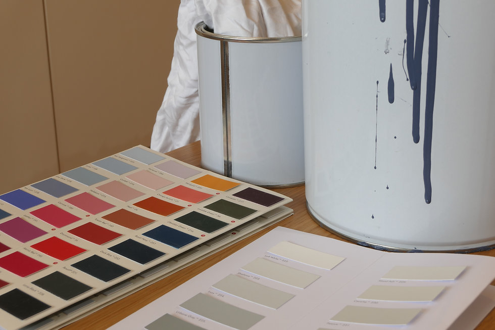 Paint swatches and white paint cans