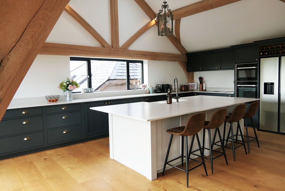 A handmade two-toned grey and white kitchen.