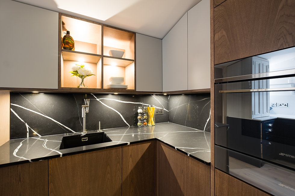A push to open german kitchen in white and walnut veneered cabinetry