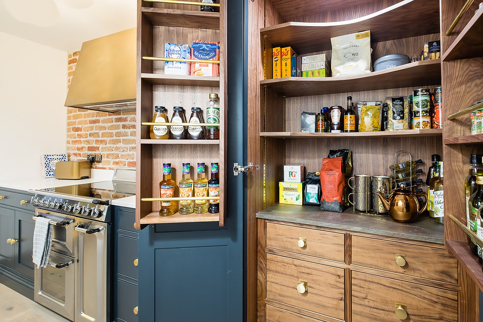 Open larder with spice racks, shelving and drawers