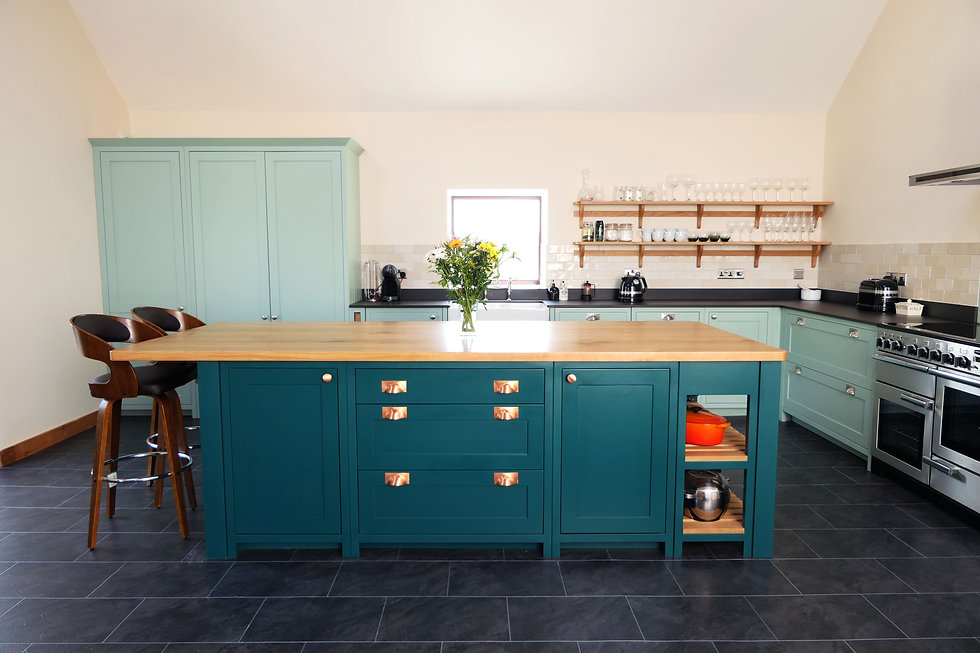 Overview of a two-toned kitchen with oak worktop