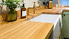 Perrin and Rowe gold taps with a white Belfst sinks and a handmade oak worktop