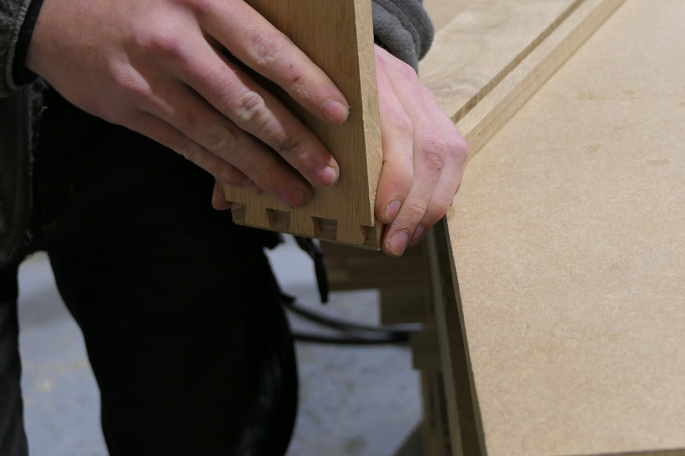 Dovetail joints being glued together