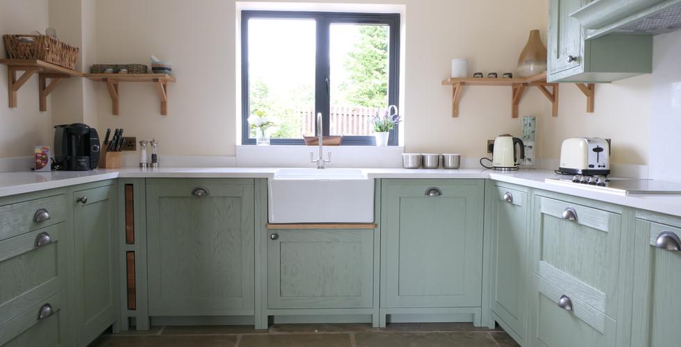 Light green handmade kitchen | Tuscany | Minerva Design