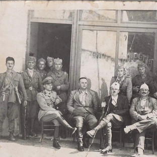 Commandant Kadri Cakrani (seated in center) with his fellow soldiers in Berat, Albania, 1944.