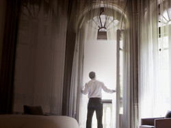 Man-Window-Hotel_travel_crop