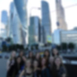 A group of NSLI-Y participants posing in front of skyscrapers in Moscow.