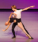 Bolshoi Ballet Academy Summer Intensive in Connecticut final performance photo featuring a male and female dancer with the female dancer doing a cambre while in sous-sus en pointe