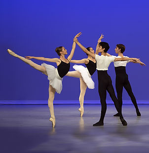 Bolshoi Ballet Academy Summer intensive in New York final performance featuring two couples with the female dancers in first arabesque.