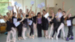 A group of NSLI-Y participants in a ballet studio posing with their certificates at the completion of the program