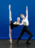 Bolshoi Ballet Academy Summer Intensive in New York final performance photo featuring a male and female dancer on stage with the female dancer in penché en pointe