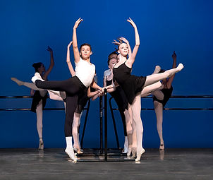 Bolshoi Ballet Academy Summer intensive in Connecticut final performance photo featuring a male and female dancer at the barre in attitude derrière