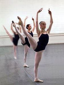 Bolshoi Ballet Academy summer intensive participants in a studio holding a développé à la seconde.