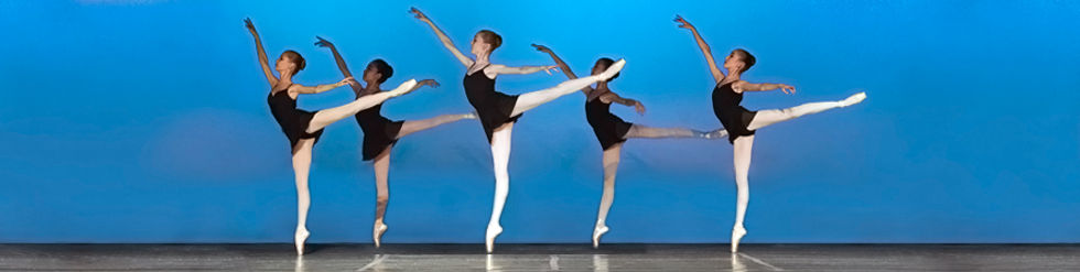 5 femal dancers on stage with in fist arabesque en pointe.