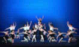 Bolshoi Ballet Academy Summer Intensive in New York final performance photo featuring a group of dancers holding the final pose on stage with a blue backdrop