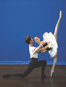 Bolshoi Ballet Academy Summer Intensive in New York final performance photo featuring a male and female dancer on stage with the male supporting the female in penche en pointe.