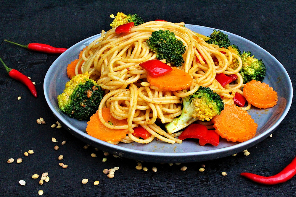 Panang Spaghetti on a plate with carrots, broccoli and red peppers